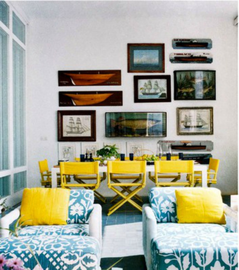 Coastal nautical dining room with wall of ship decor