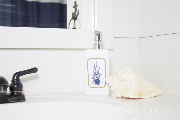 Can't find the perfect bath accessories? DIY them! Check out this nautical soap dispenser.