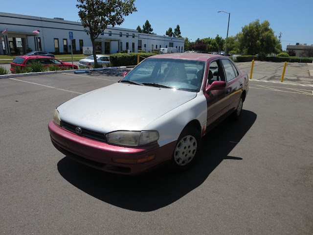 1995 Camry with collision damage before repairs at Almost Everything Auto Body