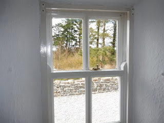 View through window of Mac Diarmda Cottage 2016