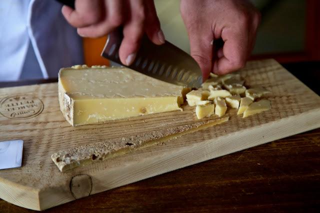 Chipping a piece of mature 3 year old Comté, Fort de Saint-Antoine, Franche-Comté