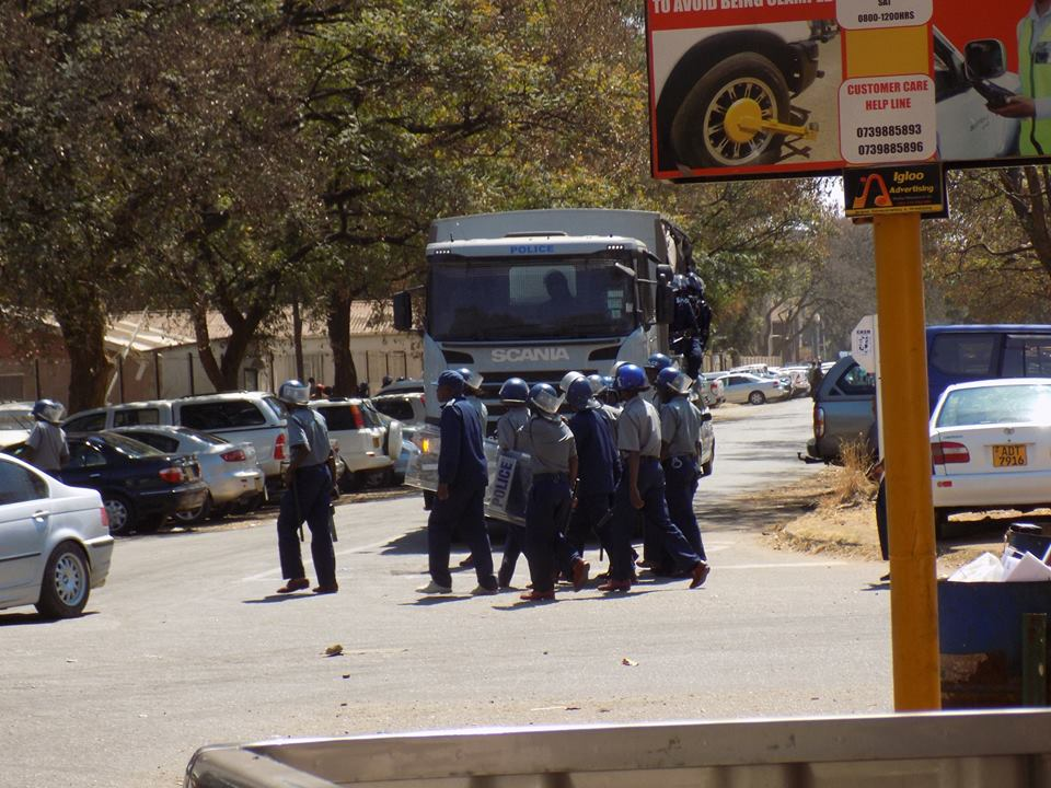 Zimbabwe charges 68 with violence after protests