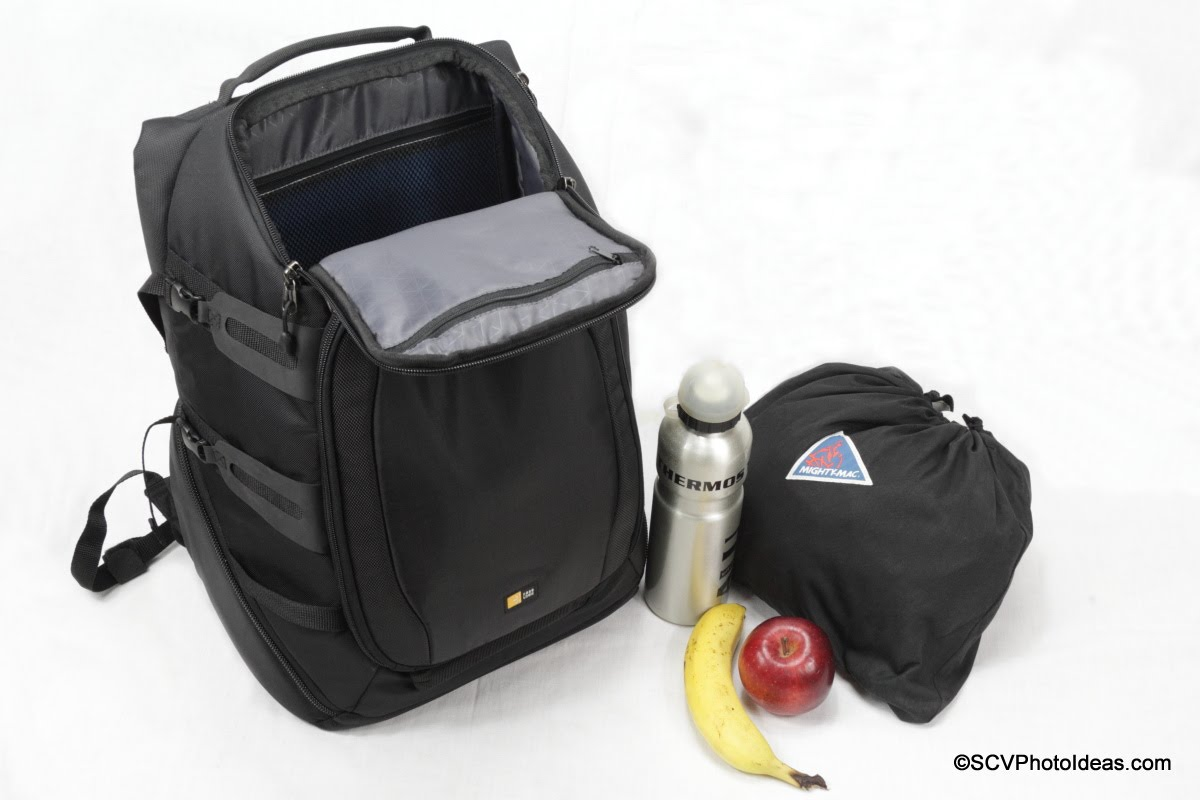 Case Logic DSB-103 w/ windbreaker, water bottle and fruit
