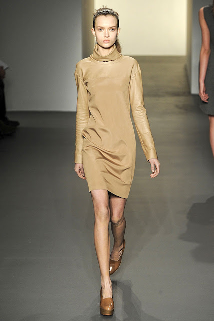 model wearing a light brown turtleneck dress from Calvin Klein's Fall Ready to Wear 2011