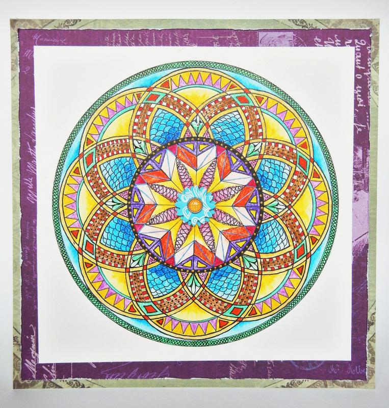 Mandala kolorowana kredkami akwarelowymi