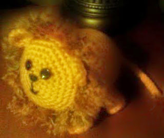 http://www.craftsy.com/pattern/crocheting/toy/larry-the-lion-amigurumi/20490
