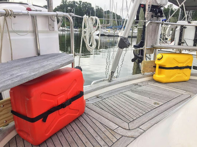 Jerry cans, fuel jugs, Hallberg-Rassy 37, gin and tonic seats, wood brackets, U-clamp