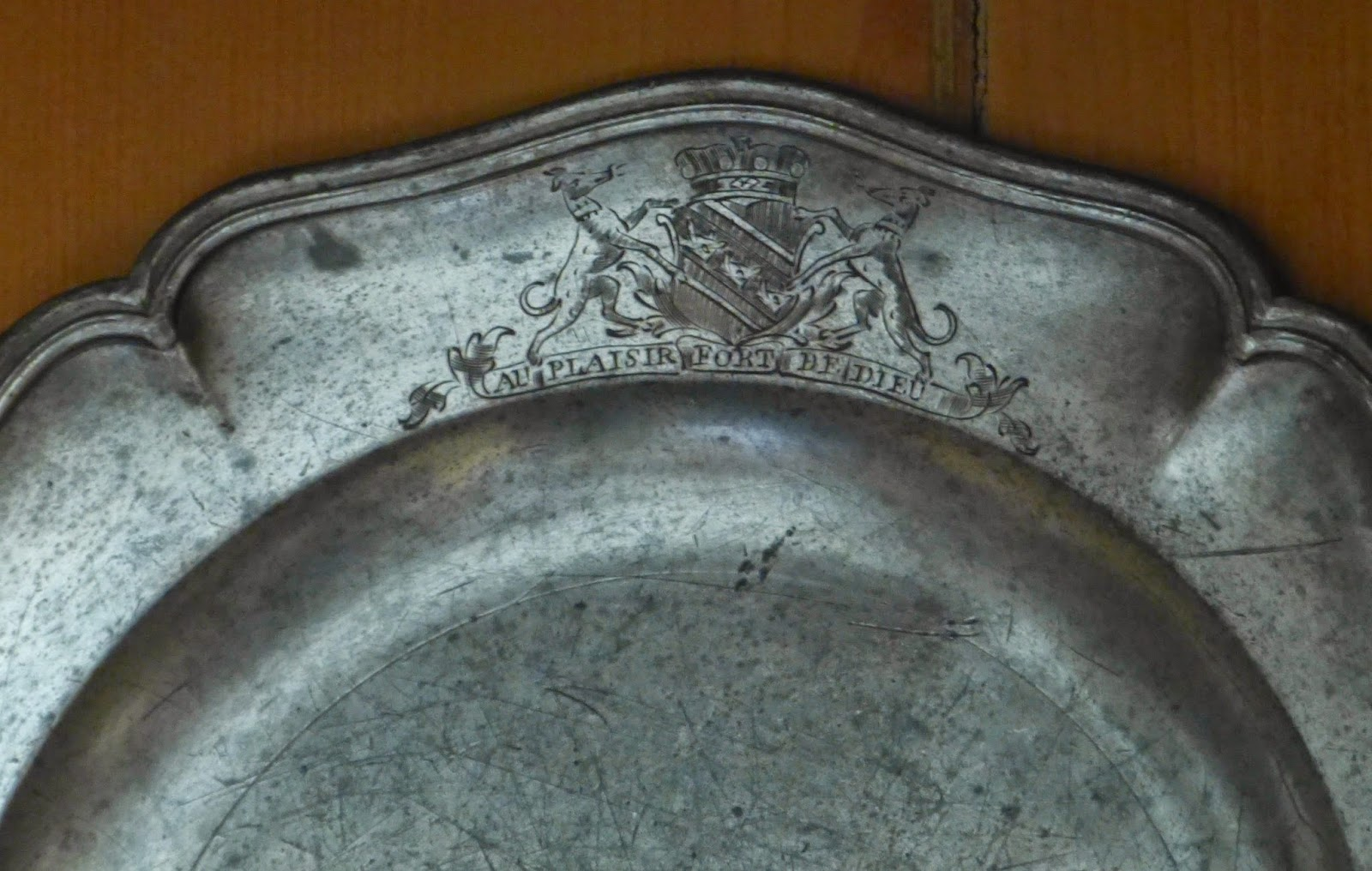 The old family pewter engraved with the Edgcumbe coat of arms