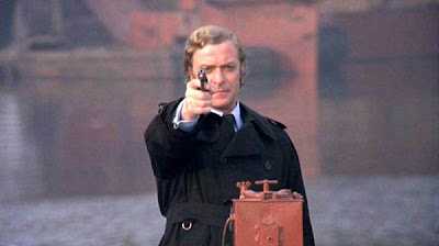 Michael Caine as Jack Carter, takes an aim, shoots his revolver/pistol, Get Carter, Directed by Mike Hodges