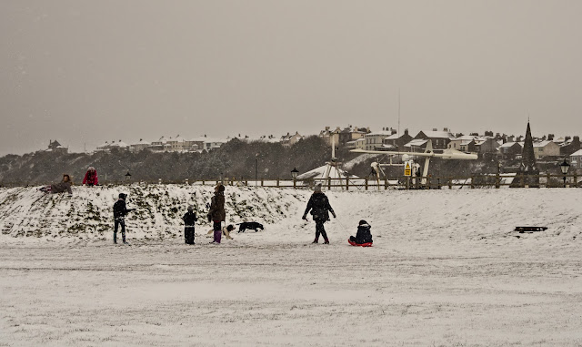 Photo of youngsters playing in the snow near Maryport harbour