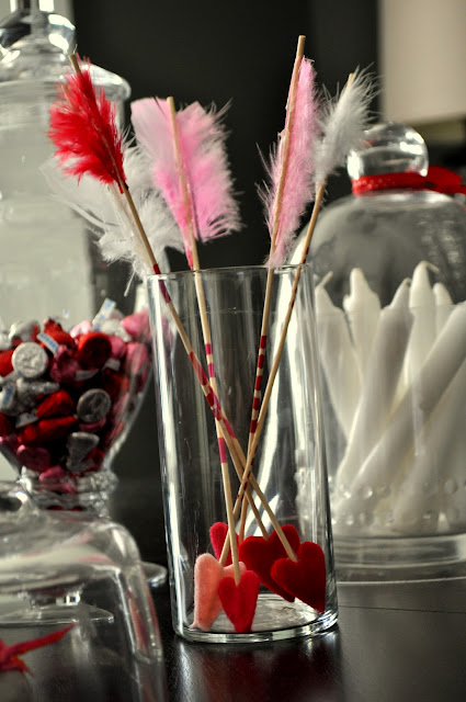 Love these cupid's arrows for valentine's candy decor! What a fun idea.