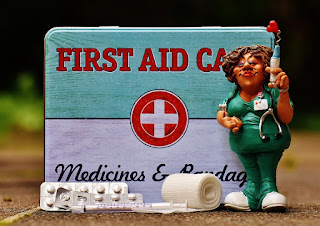 cna first aid kit and doll