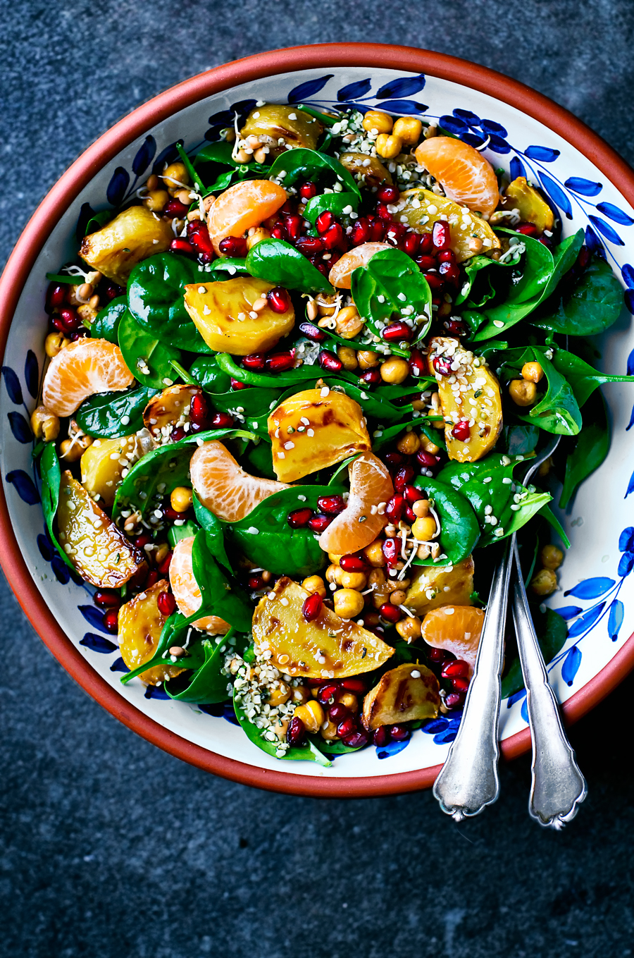Winter spinach salad with roasted beets, mandarin, pomegranate, and roasted chickpeas. This jewel toned salad is perfect for lunches and a nice way to get some veggies in, even in wintertime. With a balsamic ginger vinaigrette.