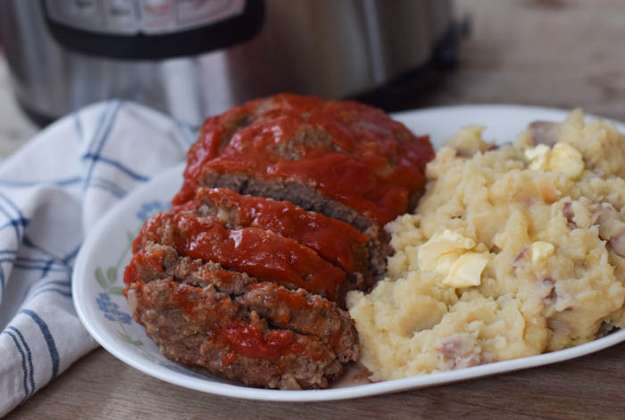 Instant Pot Meatloaf and Mashed Potatoes is an easy meal cooking two comfort food classics made quickly together in one pot.