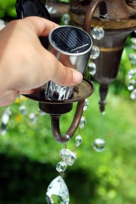 What a great idea!...add inexpensive solar lights to an old chandelier for outdoor lighting!