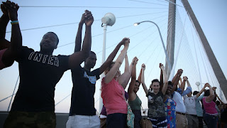 http://www.wltx.com/story/news/2015/06/21/people-link-arms-across-charlestons-ravenel-bridge/29093187/