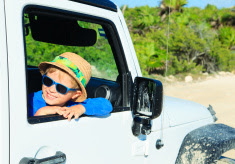 Happy Child Traveling in Car