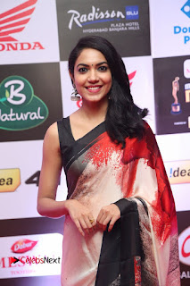 Actress Ritu Varma Pictures in Red Saree at Mirchi Music Awards South 2015 0004
