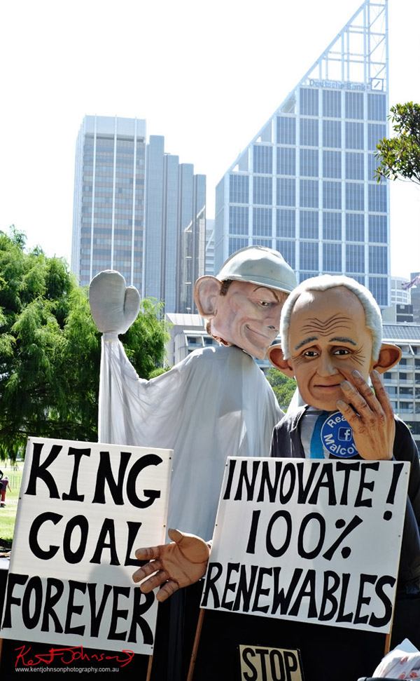 Giant puppets, Tony Abbot, Malcolm Turnbull, CBD Hi-rise in background, King Coal Forever slogan - Sydney, Climate Change March, The Domain, Macquarie Street, Climate Change, Protest, #NoPlanetNoFuture, #PeoplesClimate, #PeoplesClimateMarch, #Sydney,
