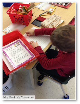 Photo of student working with alphabet stamps center.