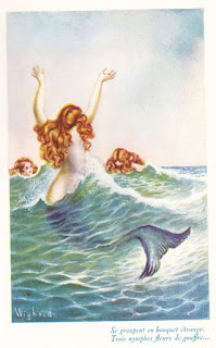 playful vintage mermaids in ocean