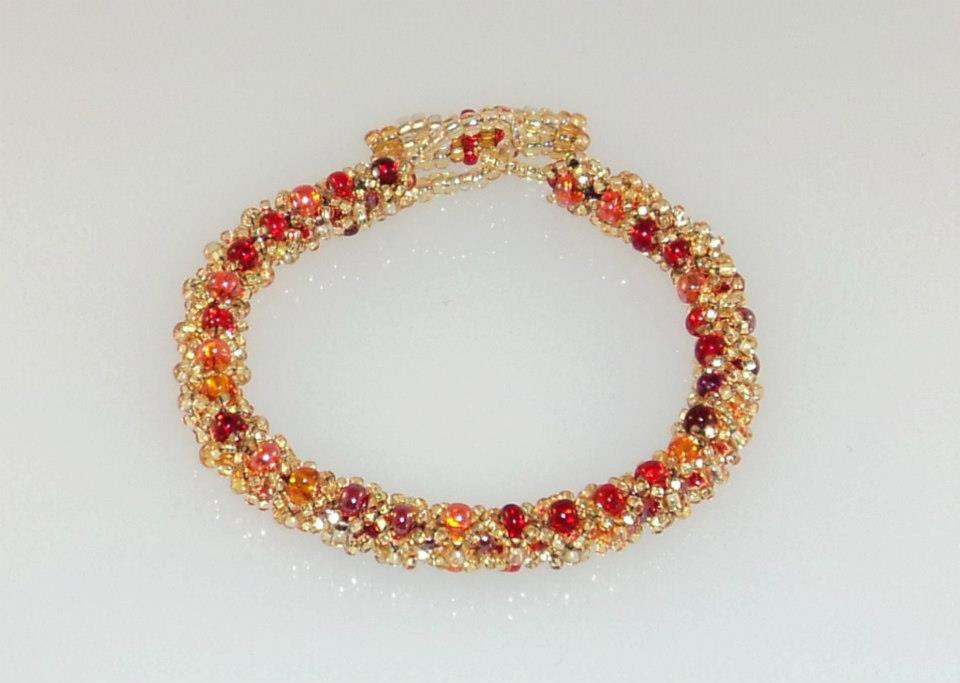 Photograph of a beaded bracelet using a DIY light box.