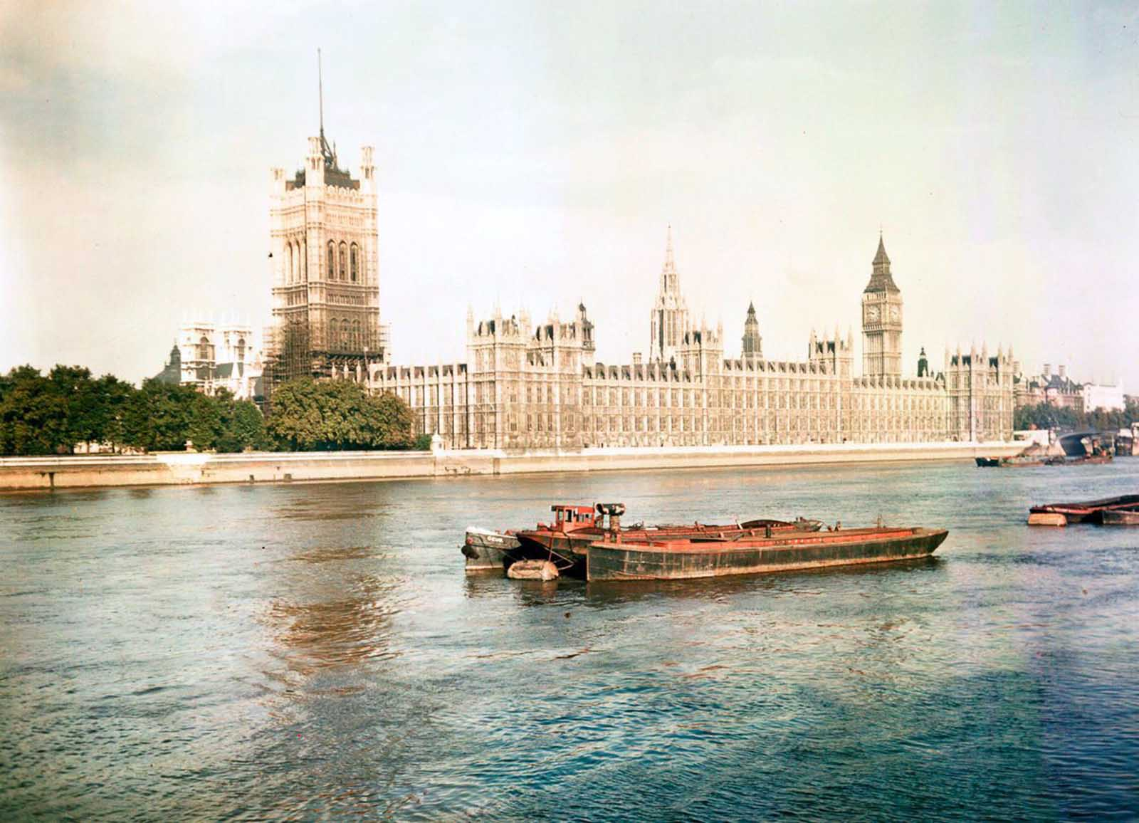 Barges on the River Thames in front of the Houses of Parliament. Dec. 10, 1945.
