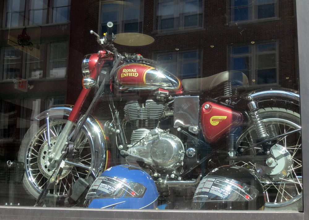 Motorcycle in store window.