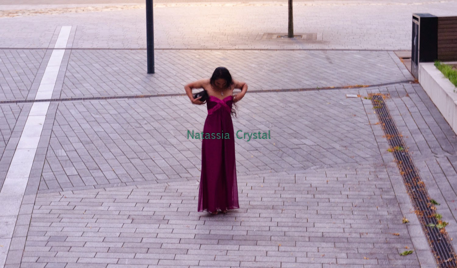 Natassia Crystal natcrys, long purple dress, outside adjusting the dress
