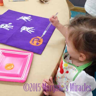 painting my trick or treat bag at Michael's craft store during a class