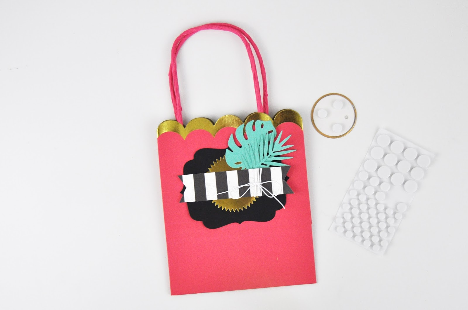 Tropical gift bag DIY. How to create tropical party favor bags with Jen Gallacher using die cut tropical leaves, label stickers, and more. #partyfavor #giftbag #papercrafter #jengallacher