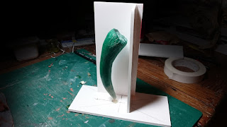 Starting to build the mold box arouns the basilisk tooth.