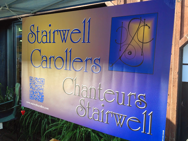 The Stairwell Carollers banner