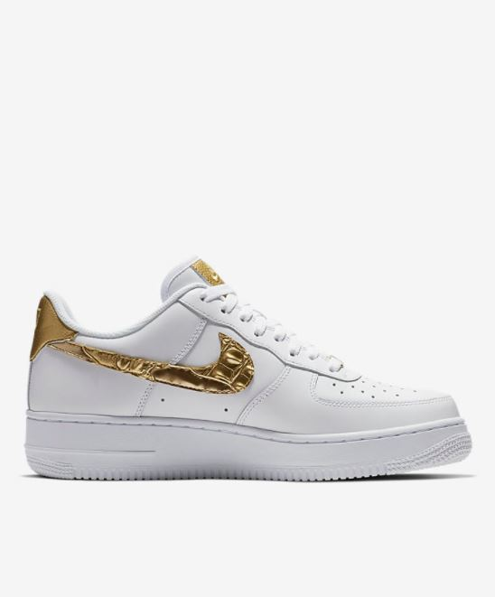 The Air Force 1 keeps its classic white look while making way for new gold  accents that nod to the superstar s legacy. A golden signature inside the  shoe ... 8812f67ab