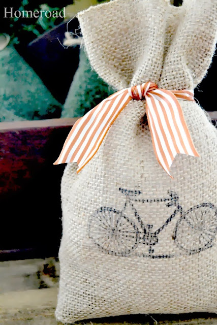 burlap gift bag with bicycle and striped bow