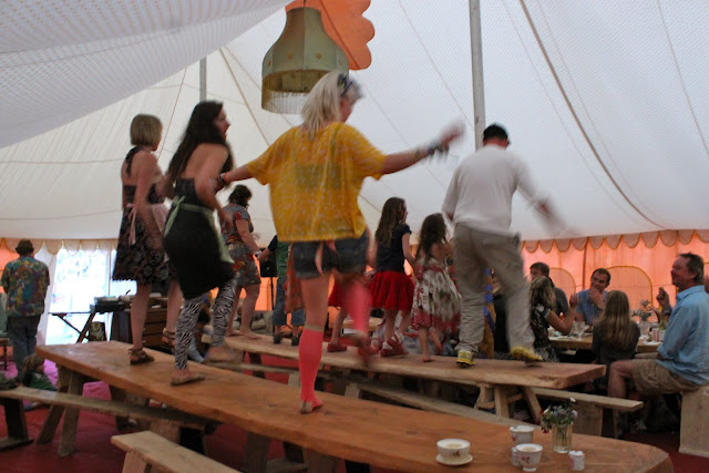 Dancing on the tables to 'Those were the days my friend""