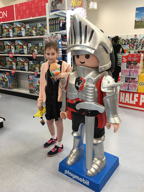 Sasha with a giant Playmobil character