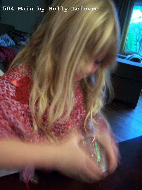 little girl shaking her firework jar