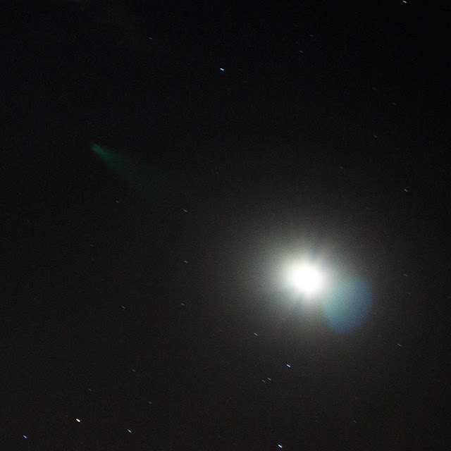 Cropped 28mm image of moon and comet 200P/Larsen and internal reflection (Source: Palmia Observatory)