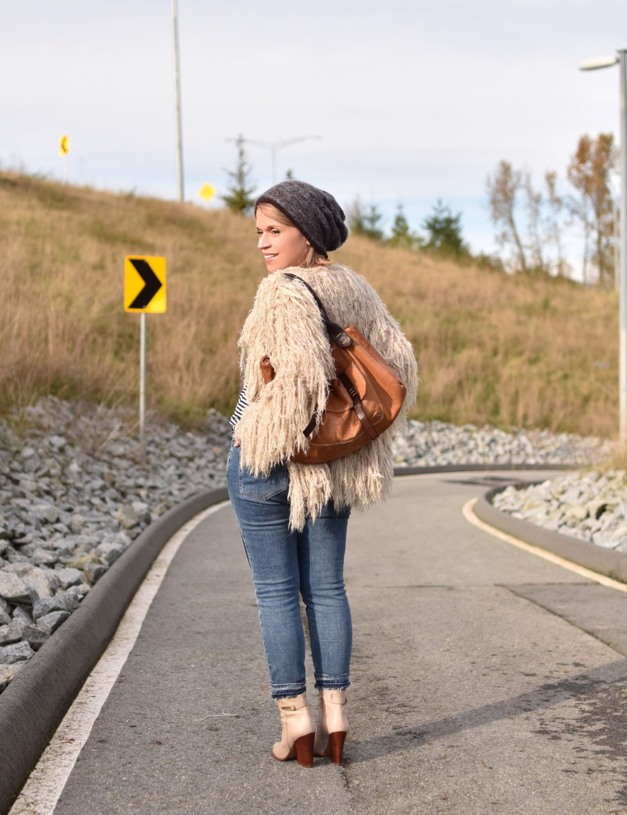 Outfit inspiration c/o Monika Faulkner - styling a shaggy cardigan with a striped tee, patchwork skinnies, ivory booties, and a woolen beanie