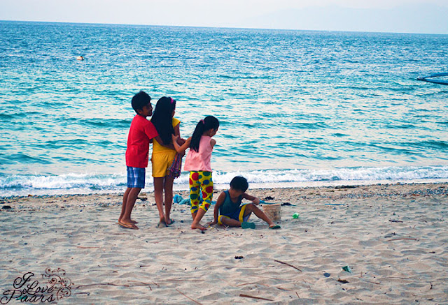 kids playing at the beach of Talipanan Beach