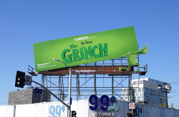 Grinch lifting billboard