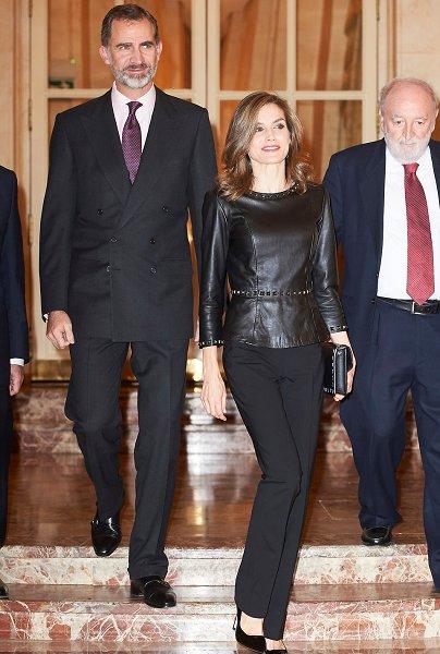 Queen Letizia wore UTERQUE Peplum Nappa Top, Hugo Boss trousers, mango Clutch, magrit Pumps, Tous Earrings, Sofia Cashmere Women's Black Fox Fur and Cashmere Cape
