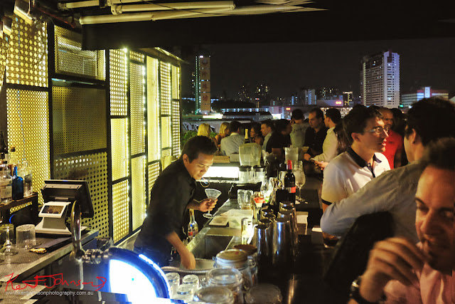 A view of the bar and the rooftop view of Singapore at Screening Room. Photo by Kent Johnson for Street Fashion Sydney.