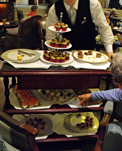 cake trolley full of petit fours