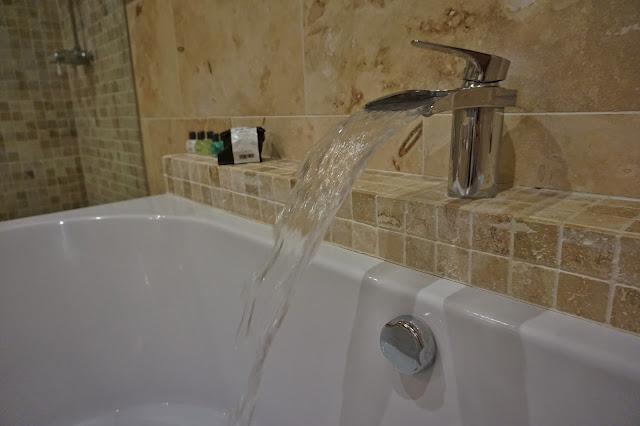 running tap into bath
