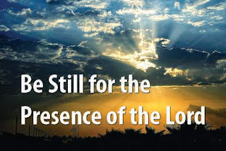 1  Be still, for the presence of the Lord, the Holy One, is here; Come bow before him now with reverence and fear: In him no sin is found - we stand on holy ground. Be still, for the presence of the Lord, the Holy One, is here.   2  Be still, for the glory of the Lord is shining all around;   He burns with holy fire, with splendour he is crowned: How awesome is the sight - our radiant King of light! Be still, for the glory of the Lord is shining all around.  3  Be still, for the power of the Lord is moving in this place;  He comes to cleanse and heal, to minister his grace - No work too hard for him. In faith receive from him. Be still, for the power of the Lord is moving in this place.