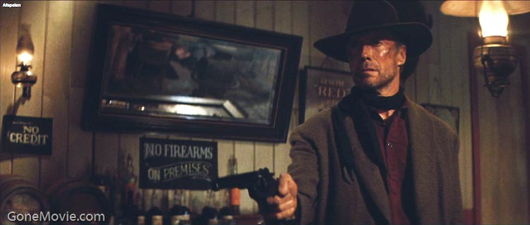 Clint Eastwood holding gun Unforgiven 1992 movieloversreviews.blogspot.com