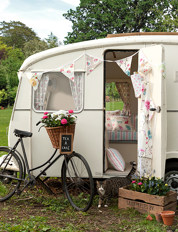 An Awesome DIY Caravan full of Clarke and Clarke fabrics. I love that vintage bike with basket! I definitely need to make a pair of curtains like those. And a garland!
