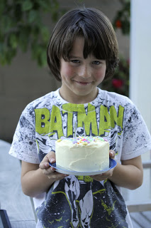 Child holding a cake
